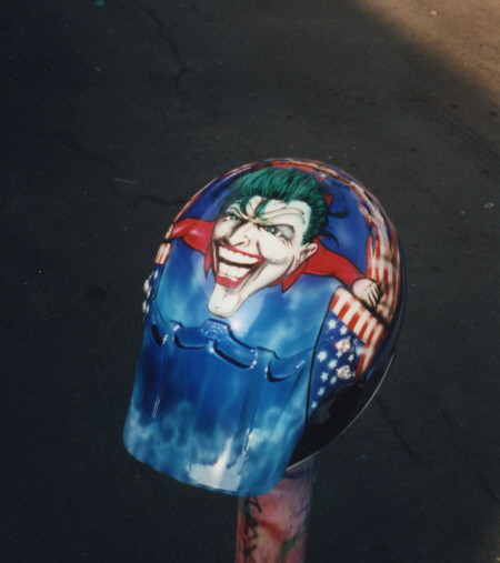 blue custom airbrushed helmet with flag design and green hair character on top