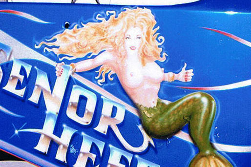 Custom airbrush graphics art of a mermaid painted on side of race car