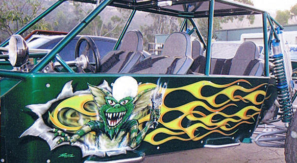 custom airbrush painted artwork on green sand rail dune buggy with a green gremlin and flame paint job