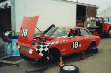 red race car with checkerd flag airbrush graphics